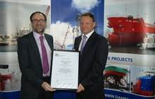 Mr Lars Seistrup, Managing Director of Albwardy Damen, is receiving the new ISO9000 certificate from Mr Brian Baxter, Area Field Service Manager, LRQA (Lloyds)